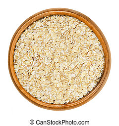 Oatmeal, rolled white oats in wooden bowl