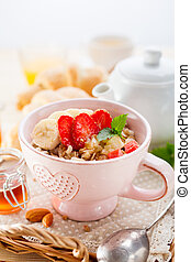Oatmeal with banana and strawberries.
