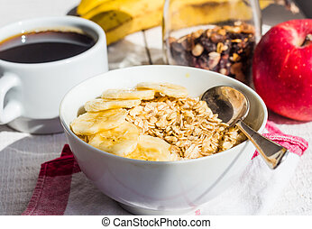 oatmeal with bananas, apples, nuts and dried fruit jar