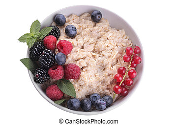 Oatmeal with berries in a bowl on white isolated background. breakfast. healthy food