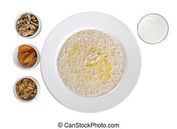 Oatmeal with dried fruits and milk.