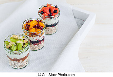 Oatmeal with fruit and cereals in a glass jar