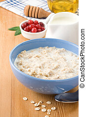 oatmeal with milk and honey on wood