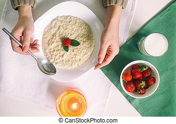 Oatmeal with milk. Porridge with milk. Cereals, delicious...