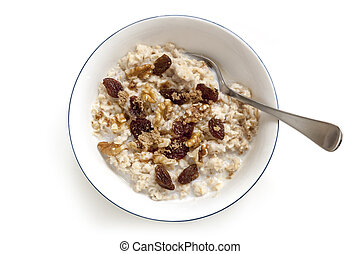 Oatmeal with Raisins Walnuts and Brown Sugar Isolated Top View