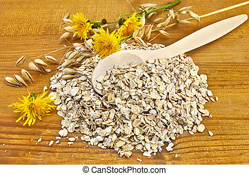 Oatmeal with stalks of oats and a spoon - Oatmeal with...