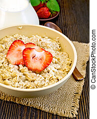 Oatmeal with strawberry on board
