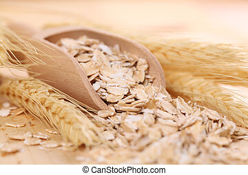 Oats - Close-up of a wooden scoop with oats