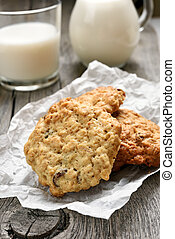 Oats cookies and milk on wooden table