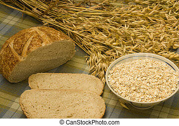 oats oatmeal and bread - grain bread with oat stalks and a...