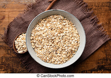Oats, rolled oat flakes or oatmeal in bowl