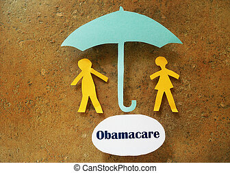 Obamacare coverage - Paper couple under umbrella and...