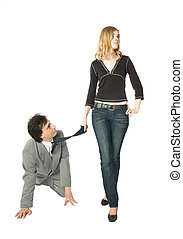 Obedience - A man on all fours and a young woman pulling him...