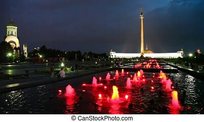 obelisk and illuminated fountains on Poklonnaya Hill at...