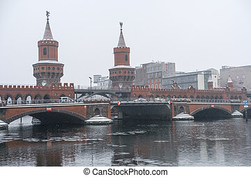 Oberbaum bridge (Oberbaumbrücke) in Berlin, winter -...
