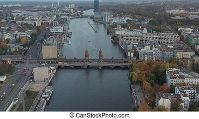 Oberbaum Bridge on Spree River in Berlin, Germany at Daytime, Aerial Dolly Truck Slide Right 4K