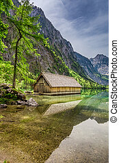 Obersee lake at spring and small wooden cottage, Alps, Germany