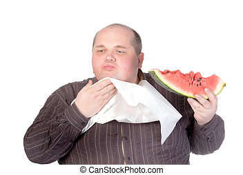 Obese man eating watermelon - Obese man with a serviette bib...