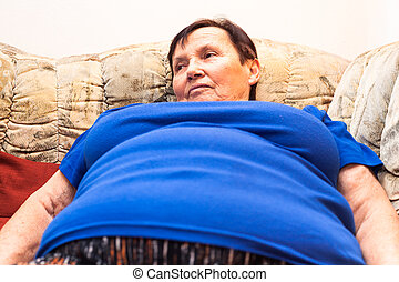 Obese senior woman - Close up of obese senior woman lying on...