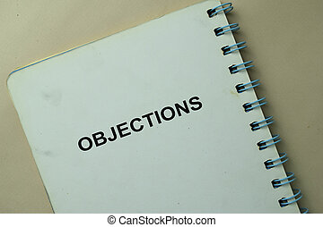 Objections write on a book isolated on office desk.