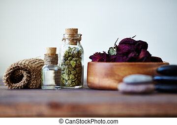 Objects for aromatherapy - Close-up of petals and oil for...