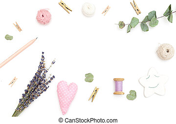 Objects for decoration on a white background in the shape of a frame. Flat lay