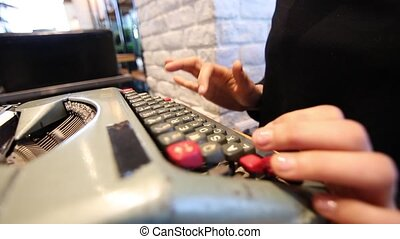Oblique close up of hands typing on typewriter - Using ...