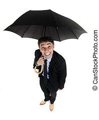 Obsequious businessman holding an umbrella