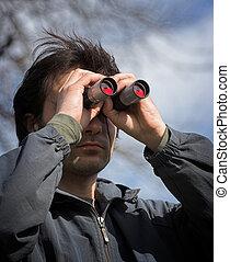 observer - Man look through the  binoculars