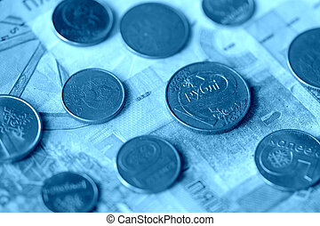 Obsolete Belarusian banknotes and coins close-up, blue color toned