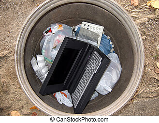 Obsolete computer thrown away in the trashcan