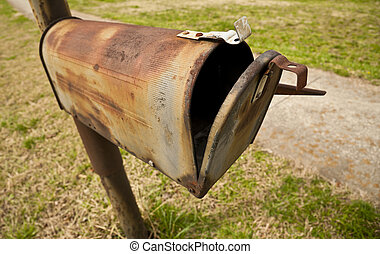 Obsolete Snail Mail Box - Horizontal shot of an old rusted...