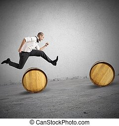 Concept of difficulty with businessman that jumps obstacles