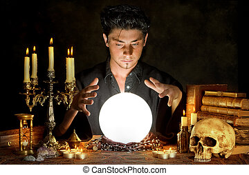 Occultism - Halloween scene of a young sorcerer and his...