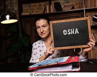 Occupational Safety and Health Administration OSHA inscription on chalkboard.