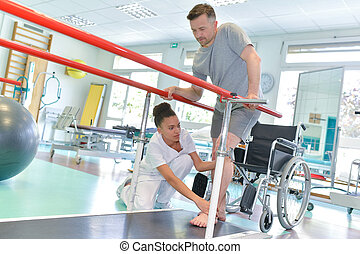 Occupational therapist helping patient to walk