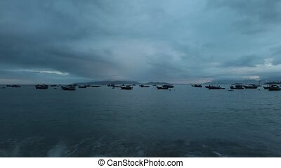 Ocean and fishing boats high definition time lapse -...