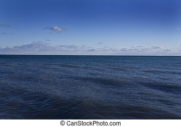 ocean and sky - blue ocean water with blue sky with white ...