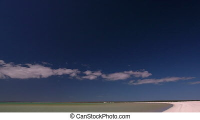Ocean and white beach shot - A wide shot of the ocean and a...