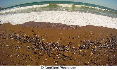 Ocean beach - Foamy ocean waves on a sandy shore.