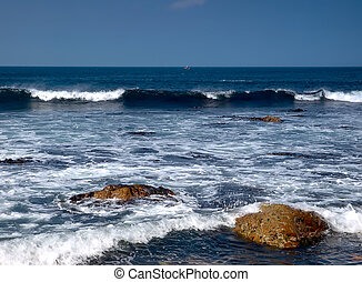 Ocean Blue - rocks and waves on Irelands West coast with...