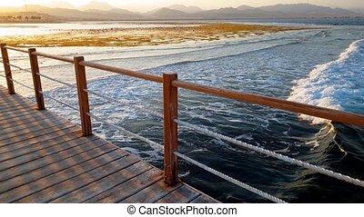 ocean., bois, sur, long, côte, vidéo, 4k, mer, vagues, rouler, jetée