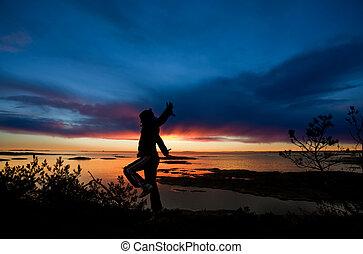 Ocean Cheer - A person running by the ocean raising their...