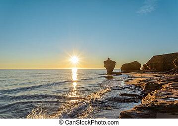 Ocean coast at the sunrise