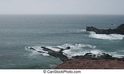 Ocean coast with rough lava rocks in Lanzarote, Canary ...