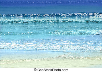 Background of colorful ocean waves sparkling in evening sun
