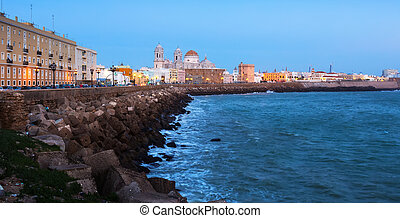 Ocean   embankment and Cathedral in twilight. Cadiz