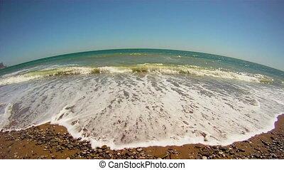 Ocean - Foamy ocean waves on a sandy shore. Sea surf.