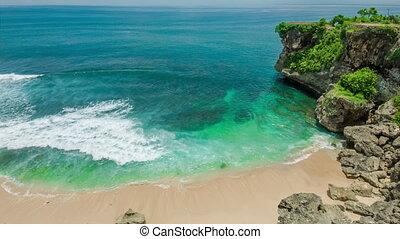Ocean laguna beach with rock and sand