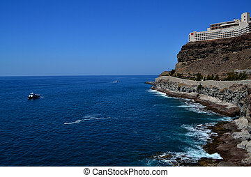 Ocean landscape - Vast ocean shore and steep cliff with a ...